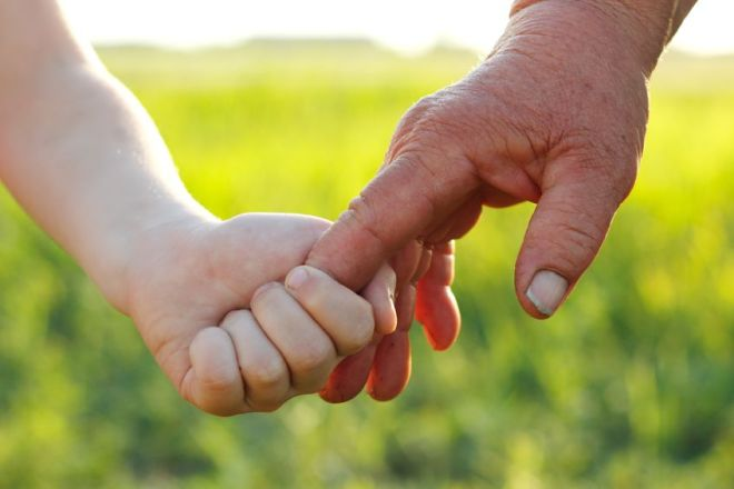 old_and_young_holding_hands